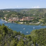Skradin: The town and busy north west quays, with yachts anchored off