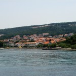 Supetar: Panorama of the town looking south east with the ferry port far left