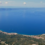 Tucepi: Aerial view of the town and harbour with Hvar Island in the distance