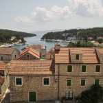 Vrboska: View seaward over the houses, showing the channel with the yacht quay right