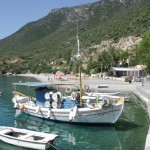 Plaka: The harbour beach with local boats