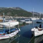 Tiros: Local boats and yachts share the harbour