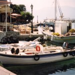 Vathi: Fishing boats with the yacht quay behind