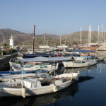 Bozburun: Fishing boats in the harbour with the two white posts marking the entrance in the background