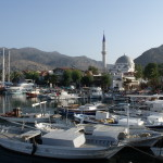 Bozbourun: Fishing boats crowd the harbour with the mosque and minaret behind