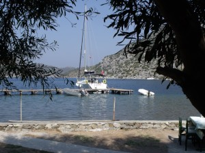 Sailor's Paradise: A yacht on the jetty from the cool shade of the trees