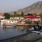 Selimiye: Holiday microcosm; a yacht, fishing boats, beach, sun loungers, restaurant, mini market and gift shop