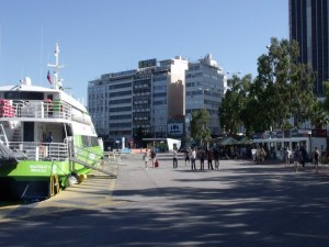 Piraeus, Athens: Poros ferry tickets are sold at the booth, right, at the window nearest the camera.
